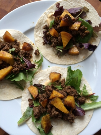 Tacos with roasted golden beets, baby Romaine salad mix, and Awesomesauce