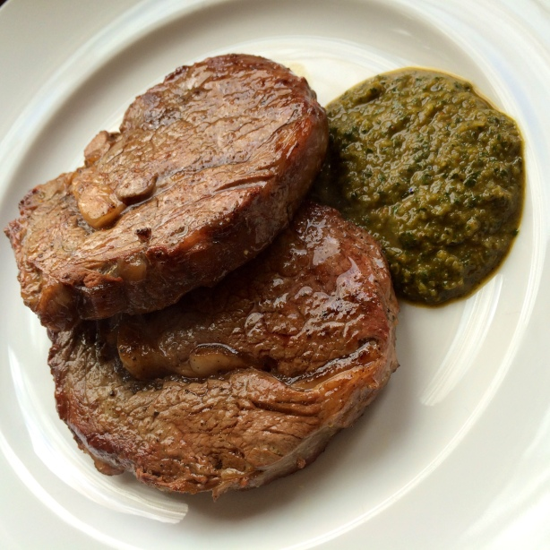 Grass-fed beef ribeyes with chimichurri