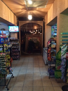 The strange entrance to Rhumb Lines: through a convenience store.