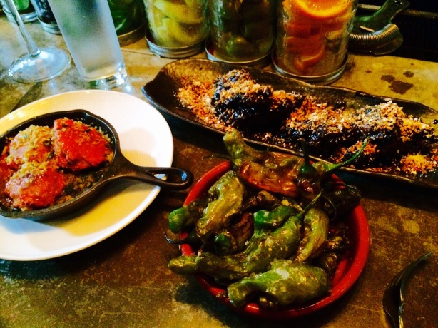 Small plates: meatballs, chicken wings with sesame and squid ink, shishito peppers.