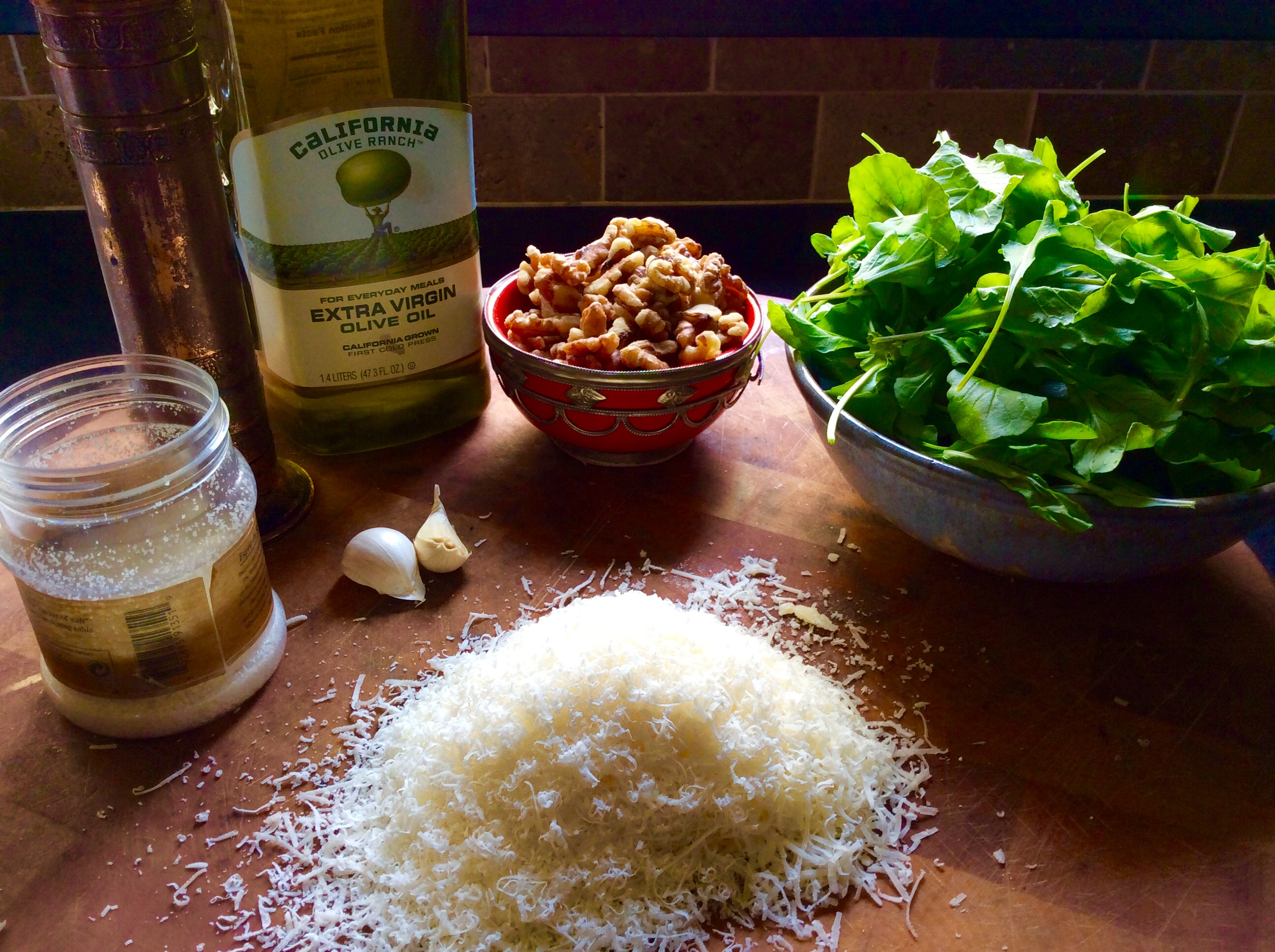 3 Cups Fresh Baby Arugula 1 2 Cup Walnuts 1 2 Cup Olive Oil 1 Clove Garlic 1 Teaspoon Salt 1 4 Teaspoon Pepper 1 2 Cup One Tablespoon Grated Parmigiano