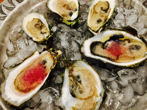 Fresh shucked oysters with pickled red onion ice.